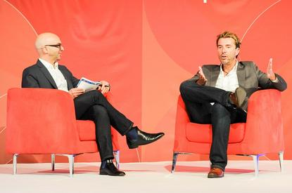 eBay enterprise vice president and CMO, Mark Kirschner, chats to Harvey Norman CDO Gary Wheelhouse during MagentoLive in Sydney.