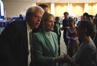 Hillary Clinton speaks to a supporter in San Francisco after receiving an award at the American Bar Association meeting on August 12, 2013.