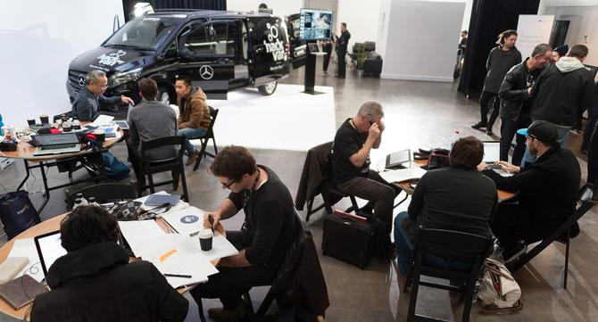 Teams working on hacking the inside of the Vito van