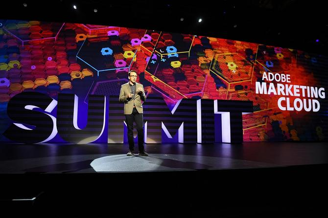 Brad Rencher on stage at this year's Adobe Digital Marketing Summit