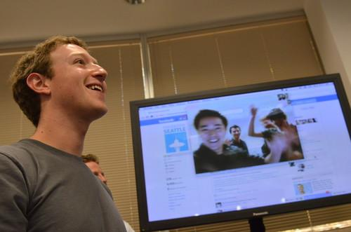 Facebook CEO Mark Zuckerberg watches a demonstration of the company's new video chat feature on Wednesday at Facebook headquarters.