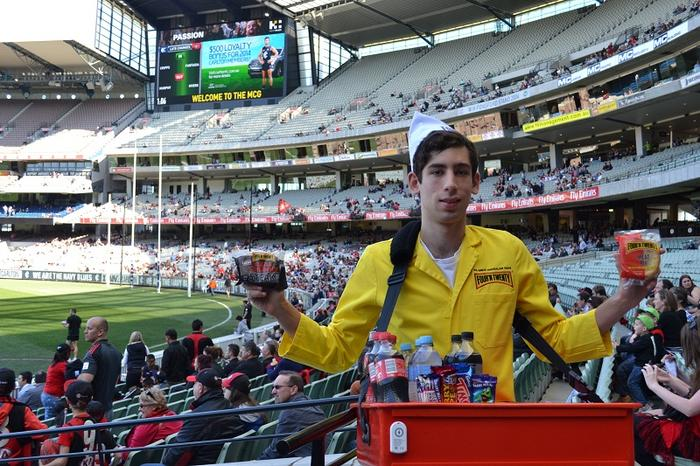 One of the pie boys offering free pies to Melbourne Cricket Ground patrons during the iBeacon trial. Photo credit: Melbourne Cricket Club.