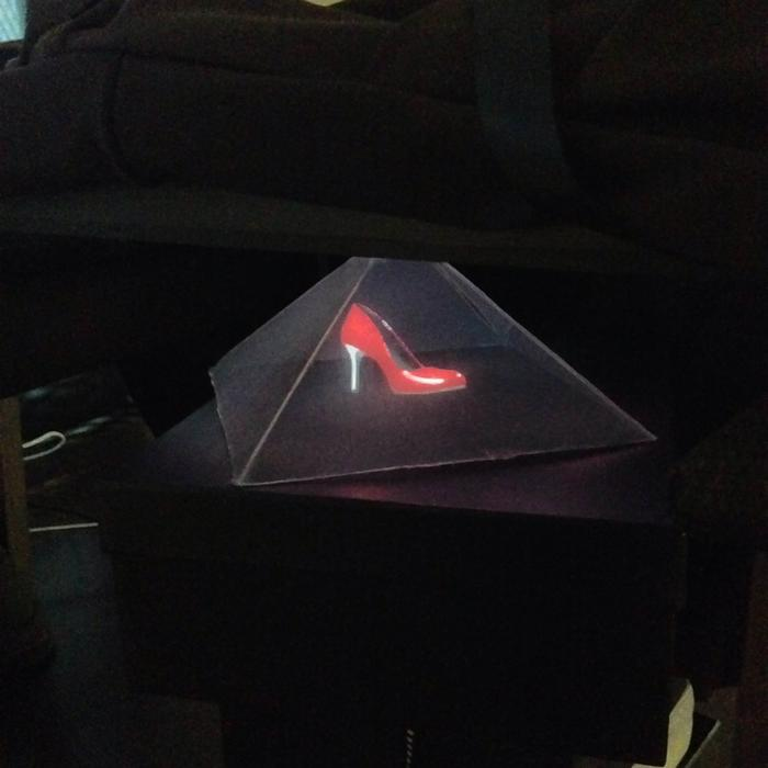 The 3D hologram technology lets customers see and manipulate the shoes they have designed before they are produced. Credit: Shoes of Prey